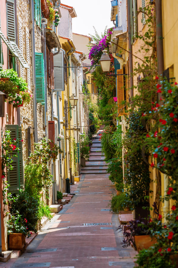 Alley with entwined houses in Antibes, France. Picturesque alley with entwined houses in Antibes, Cote Azur, France stock images