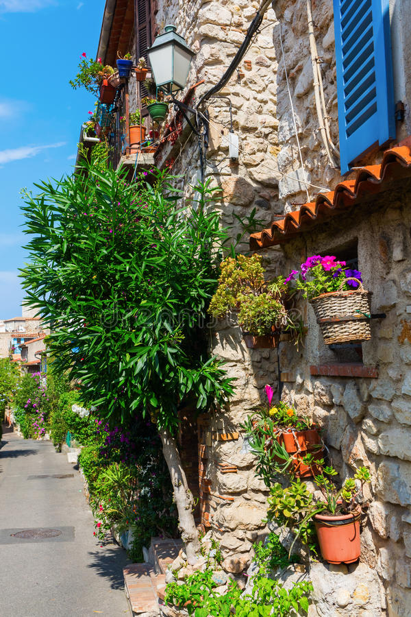 Alley with entwined houses in Antibes, France. Picturesque alley with entwined houses in Antibes, Cote Azur, France stock photography