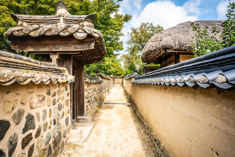 Alley with houses walls and gates in historic Hahoe folk village Andong South Korea. Alley with houses walls and gates in historic Hahoe folk village in Andong royalty free stock images
