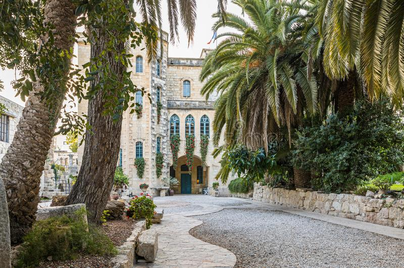 Alley leading to the Benedictine Abbey of Abu Gosh in the Chechen village Abu Ghosh near Jerusalem in Israel. Jerusalem, Israel, December 07, 2019 : Alley royalty free stock photo