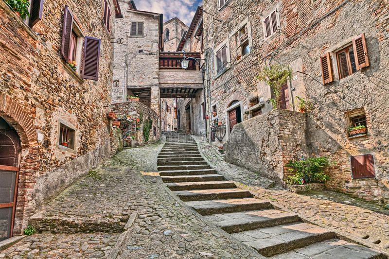 Alley in the medieval village Anghiari, Arezzo, Tuscany, Italy. Picturesque old narrow alley with staircase in the medieval village Anghiari, province of Arezzo stock photo