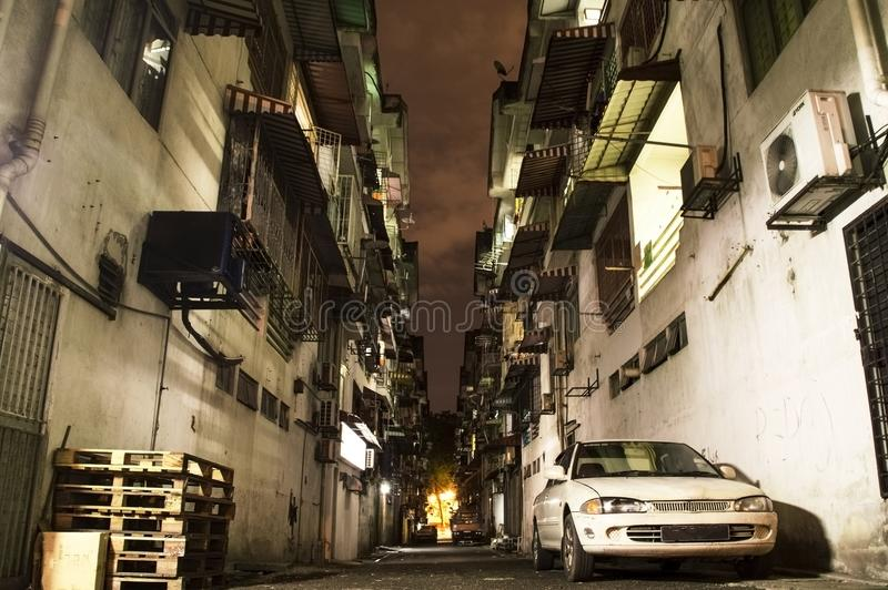 Alley in the night in Kuala Lumpur poor suburb. Of Kuchai Lama royalty free stock images