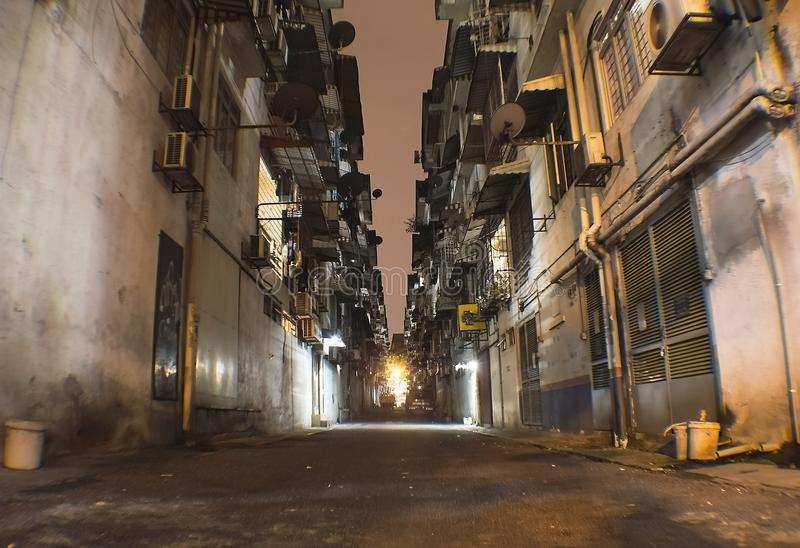 Alley in the night in Kuala Lumpur poor suburb. Of Kuchai Lama royalty free stock photography
