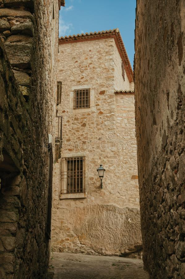 Alley with old stone buildings and public lamp at Trujillo royalty free stock photography