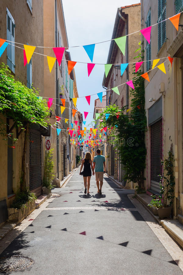 Alley in the old town of Antibes, France. Antibes, France - July 24, 2016: alley in the old town of Antibes with unidentified people. Antibes is a Mediterranean royalty free stock images