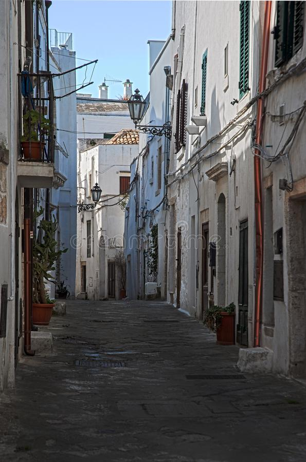 Alley in the old town of Ostuni, La Citta Bianca. Ostuni, Puglia, Italy, March 22nd 2019: Alley in the old town of Ostuni, La Citta Bianca ancient apulia stock photography
