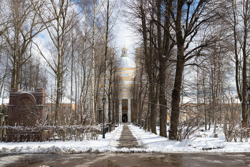 Alley to the Trinity Cathedral in April afternoon. The Alexander Nevsky Lavra, St. Petersburg. Russia stock photo