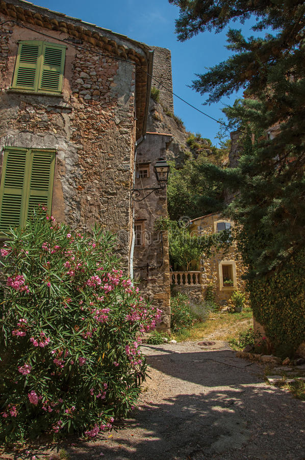 Alley view with house and flowers in Châteaudouble. Alley view with house and flowers in Châteaudouble, a quiet and tourist village with medieval origin stock image
