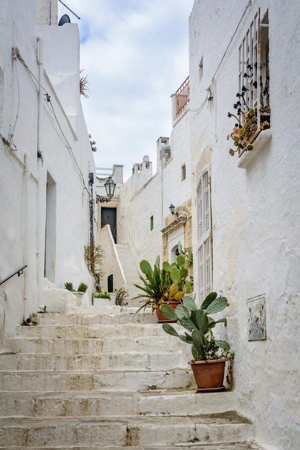 Alleyway in Ostuni, Puglia, Italy royalty free stock photography