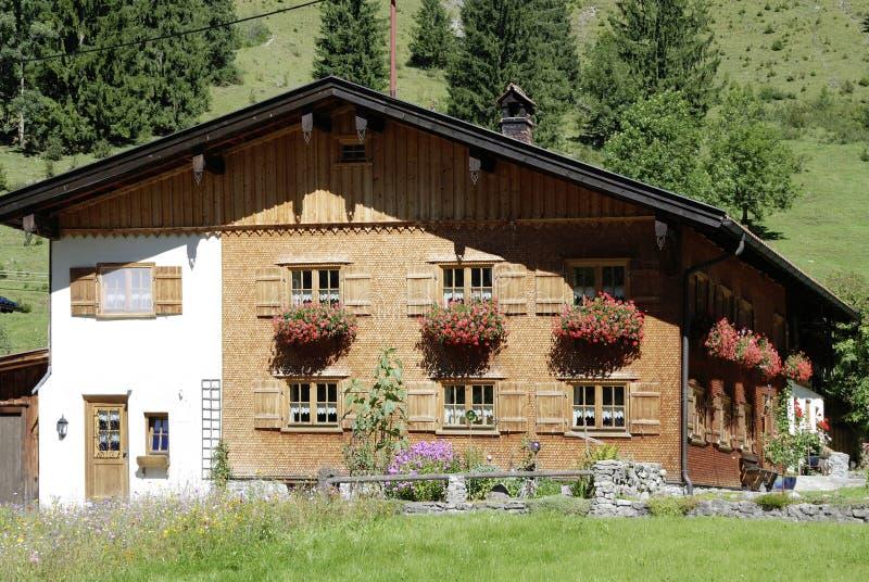 Allgaeu clapboard house in Bavaria. Allgaeu clapboard house in the mountain village of Hinterstein in Bavaria stock image