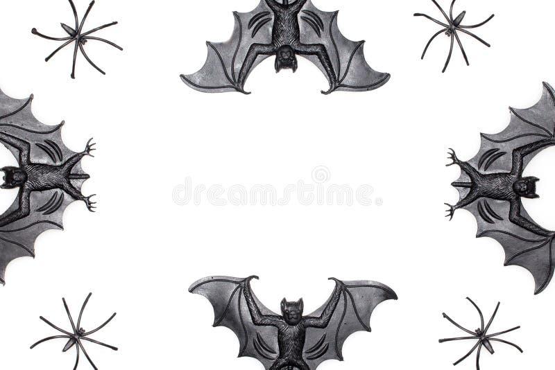 Allhelgonaaftongränsbild med för slagträ- och spindelleksaker för krimskrams spöklik nolla arkivfoton