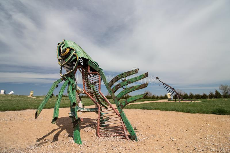 Alliance, Nebraska/USA - May 8th 2018: A peculiar metal sculpture of a fish leaping out of the ground in Nebraska royalty free stock photo