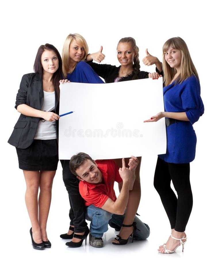 Allievi con il segno in bianco immagini stock