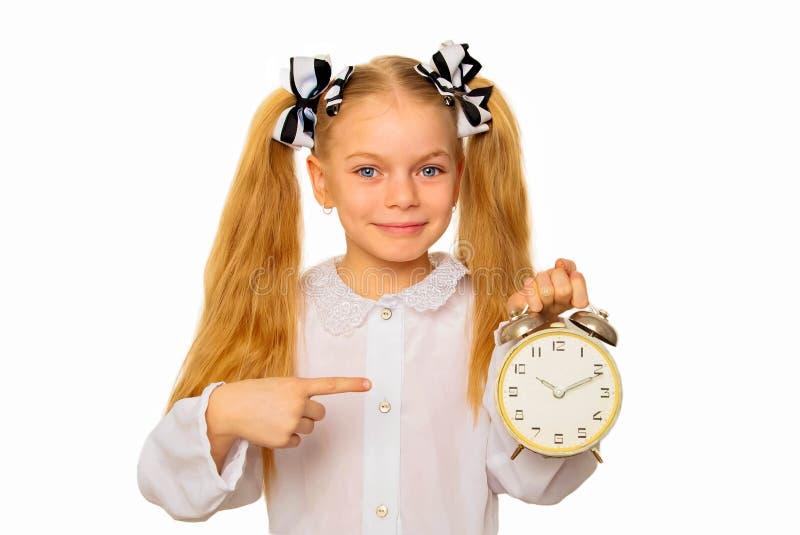 Allievo che indica l'orologio Concetto della gestione di tempo fotografie stock