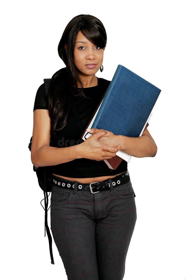 Allievo dell'afroamericano con i libri immagine stock