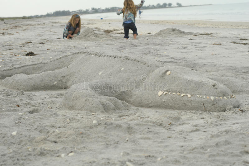 Alligator sculpture in the sand royalty free stock images