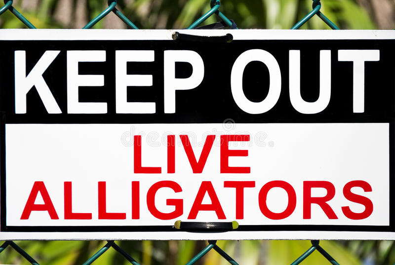 Alligators danger signal. Keep out,live alligators zone signboard stock photos
