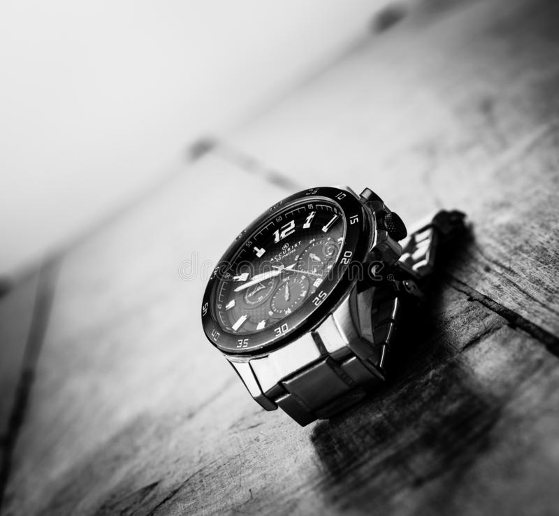Alloa, Scotland - 17 July 2019 - classic watch isolated on a dark background. Accurist man watch royalty free stock image