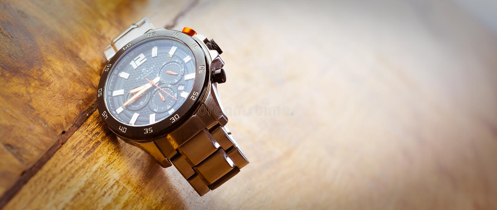 Alloa, Scotland - 17 July 2019 - expensive watch isolated on a wooden background stock photos