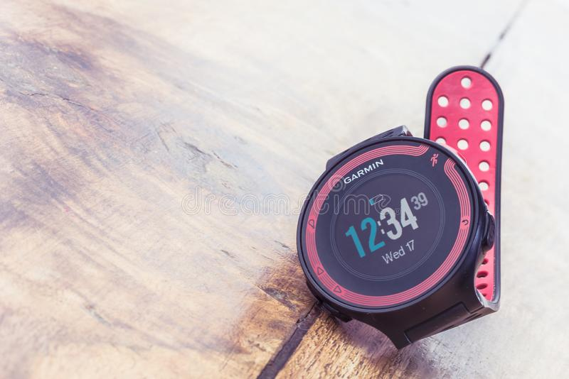 Alloa, Scotland - 17 July 2019: GARMIN FORERUNNER Multisport Watch isolated on wooden background royalty free stock images