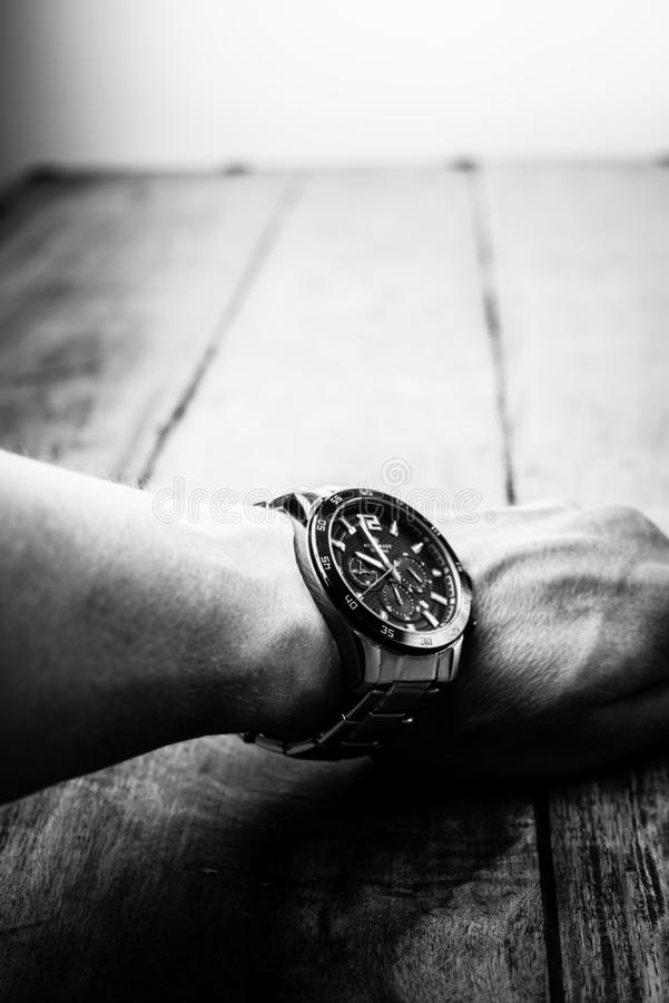 Alloa, Scotland - 17 July 2019 - wrist watch isolated on a wooden background. Accurist man watch stock photography