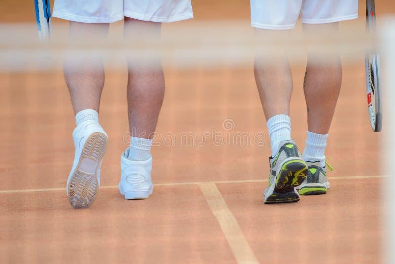 Allontanarsi dei tennis fotografia stock