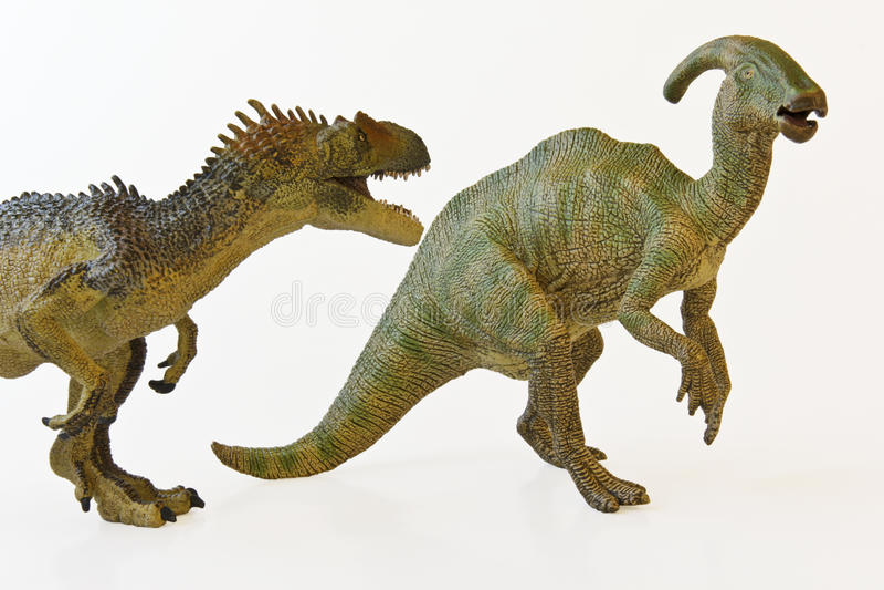 An Allosaur Menaces A Parasaurolophus Royalty Free Stock Photo