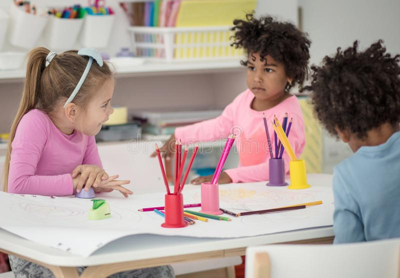 Always allow them to be free to create. Children in preschool stock photography
