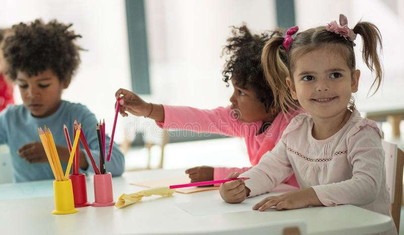 Always allow them to be free to create. Children in preschool royalty free stock photos