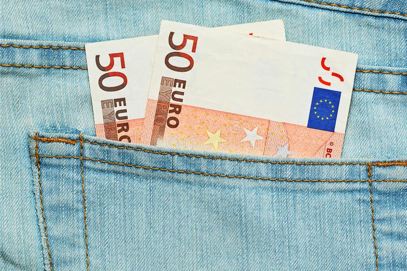 Allowance or salary in jeans pocket. Two fifty euros bank notes in jeans pocket. Small allowance or minimal salary concept royalty free stock photo