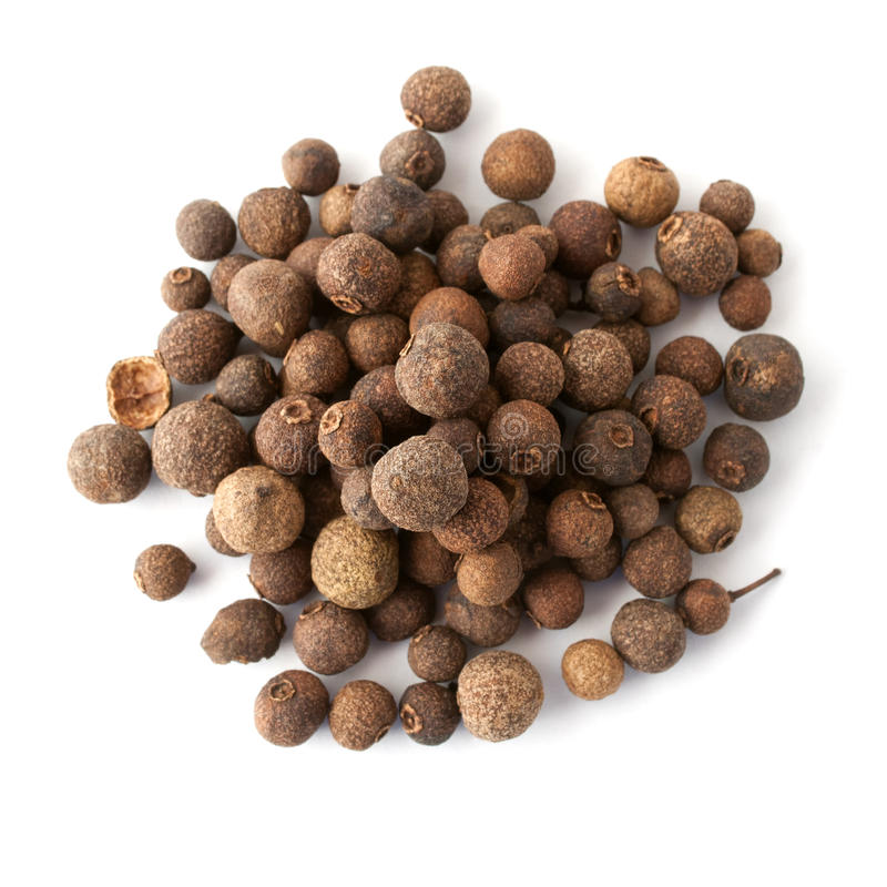 Allspice. Heap on white background. Top view royalty free stock images