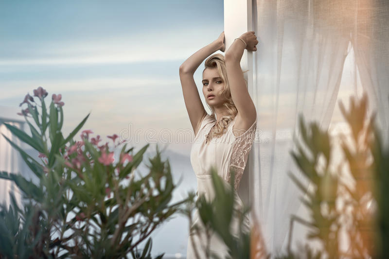 Alluring blond lady relaxing in the tropics royalty free stock photography
