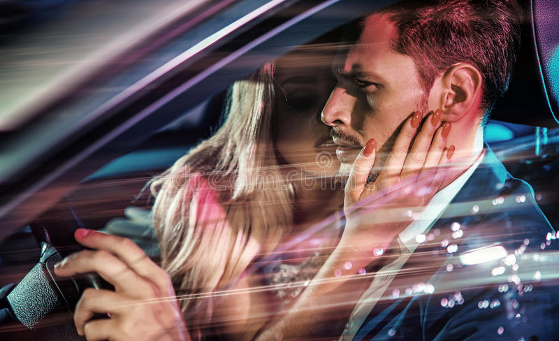 Alluring blonde looking at her driving husband stock photos
