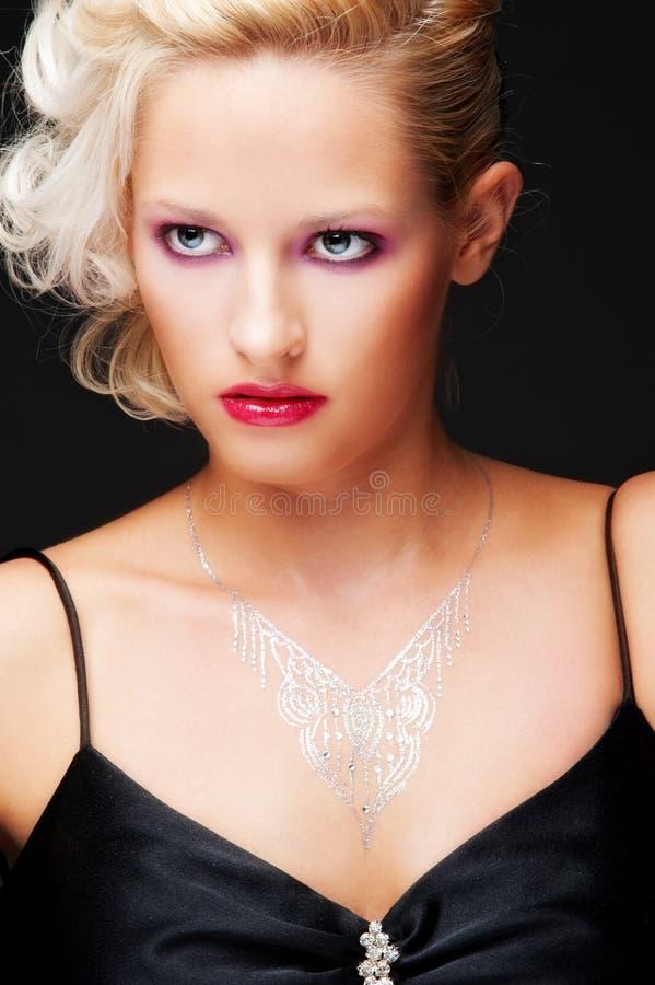 Download Alluring Blonde Over Black Background Stock Image - Image: 16647885