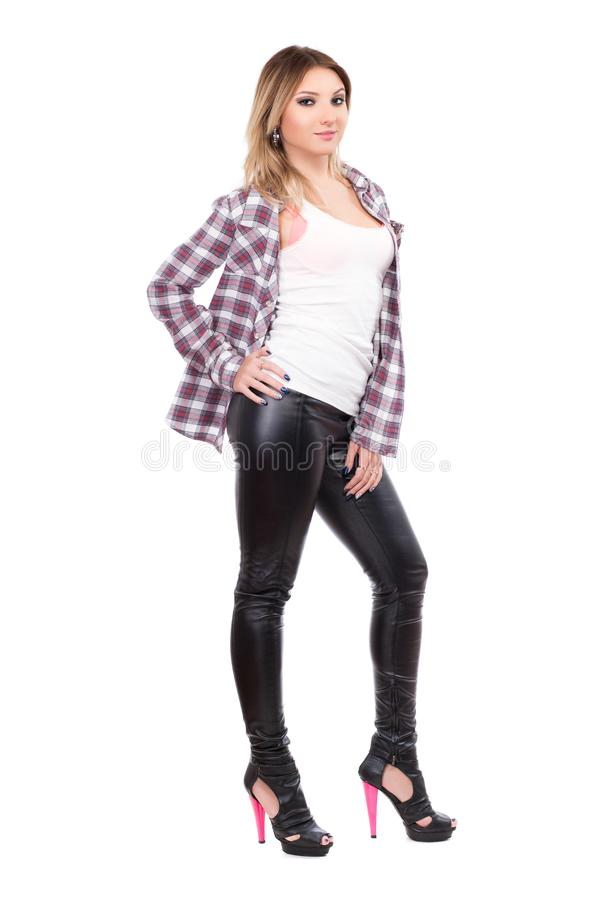 Alluring blonde wearing checked shirt. And black pants. Isolated on white royalty free stock photos