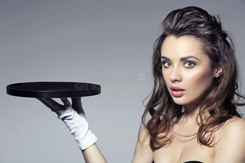 Download Beauty Brunette Holding A Tray Stock Image - Image: 30139535