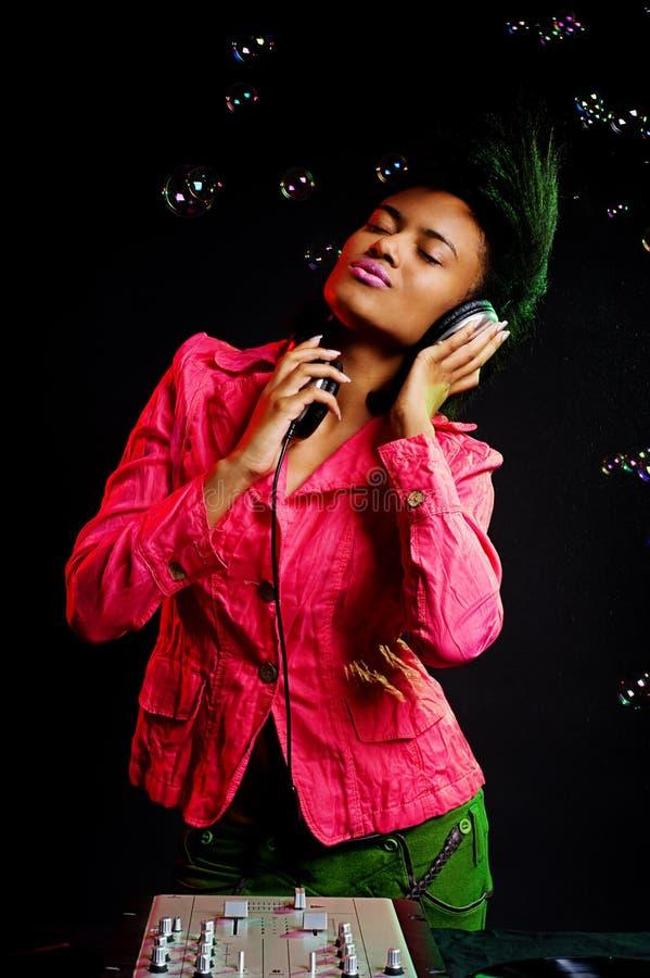 Download Alluring Dj Listening Music Stock Photo - Image of mixer, headphones: 11259452