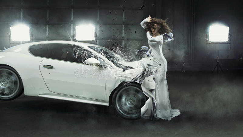 Alluring fashionable lady in the middle of car crash stock photo