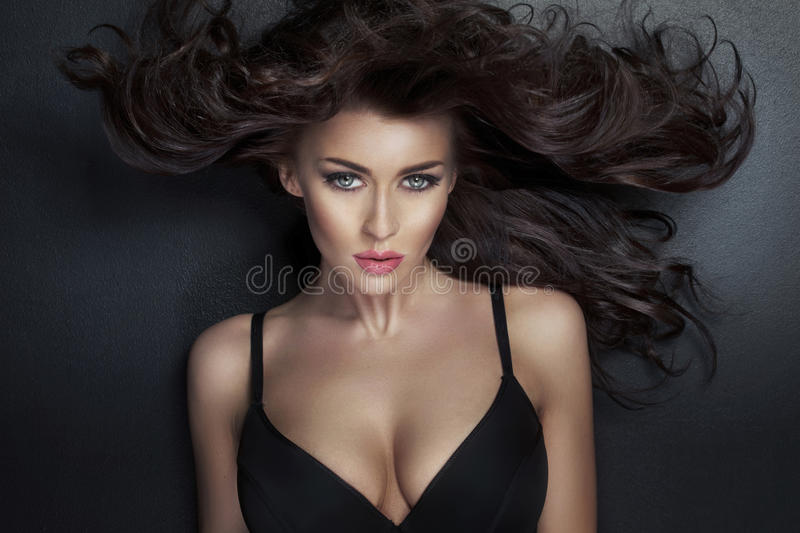 Alluring lady looking at the camera stock image