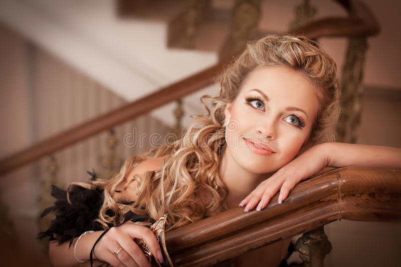 Blonde woman with diamond jewelry with hairstyle and makeup stock images
