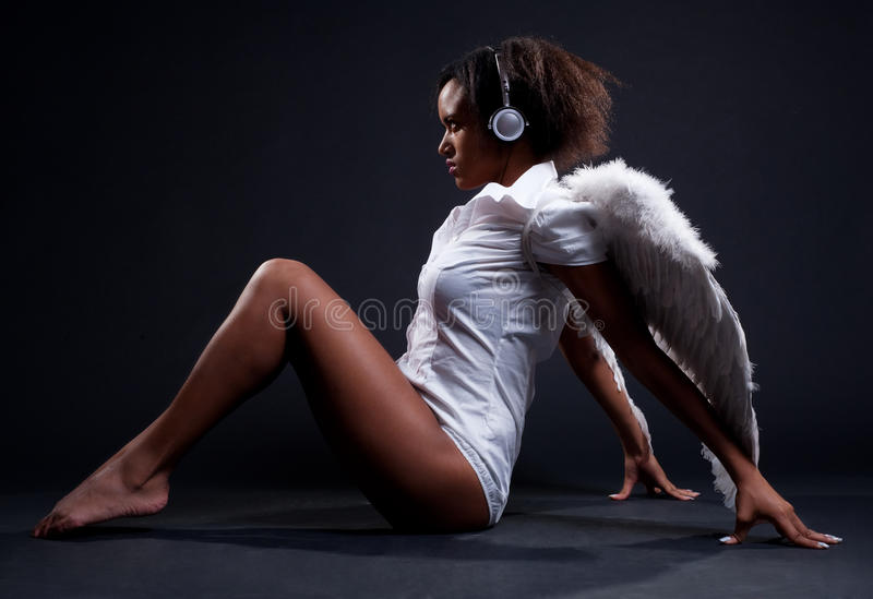 Download Alluring Woman In White Wings Stock Photo - Image: 12479748