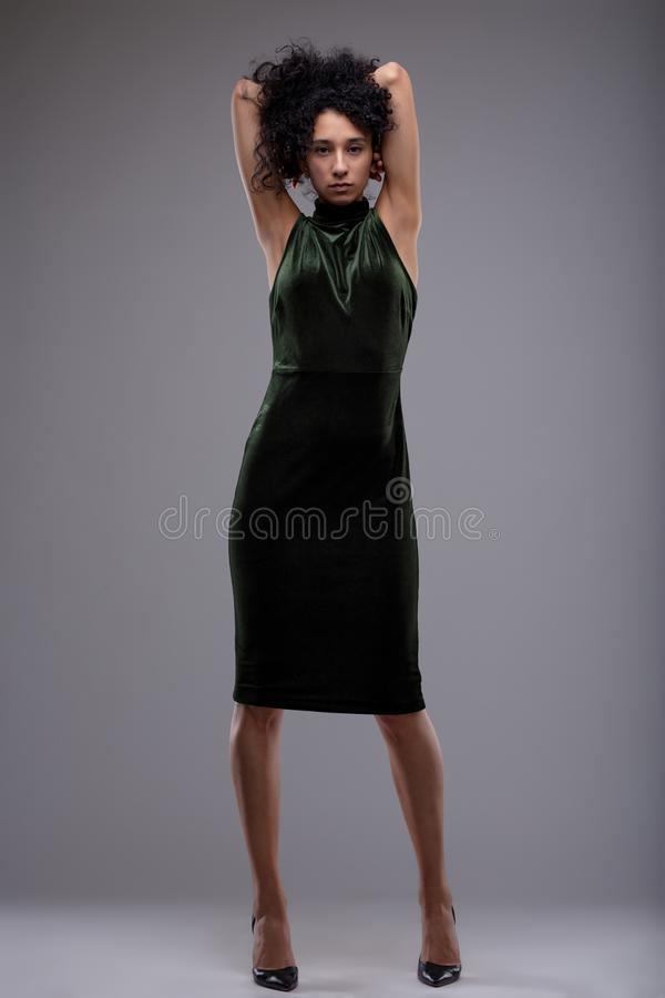 Alluring young woman in elegant black dress stock photography