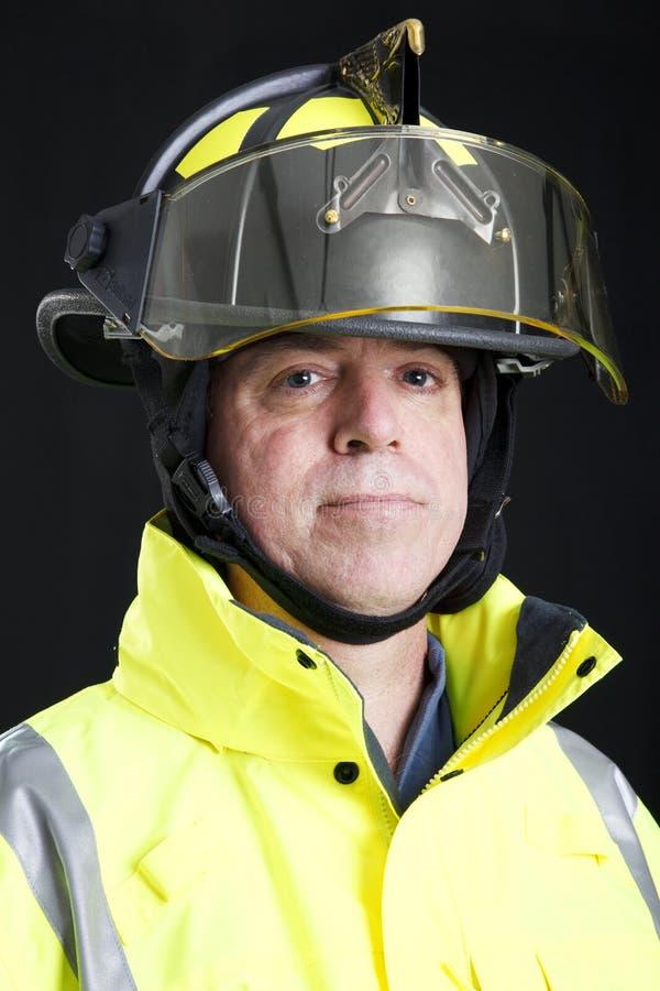 allvarlig brandmanstående royaltyfria foton