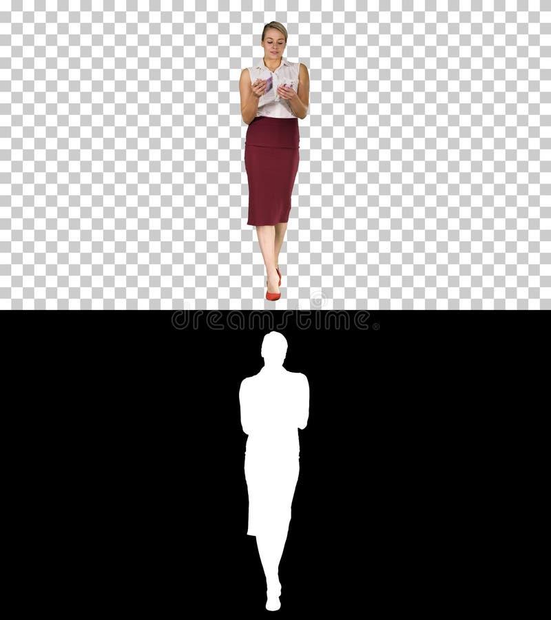 Allvarlig seende affärskvinna med euro som räknar dem, Alpha Channel fotografering för bildbyråer