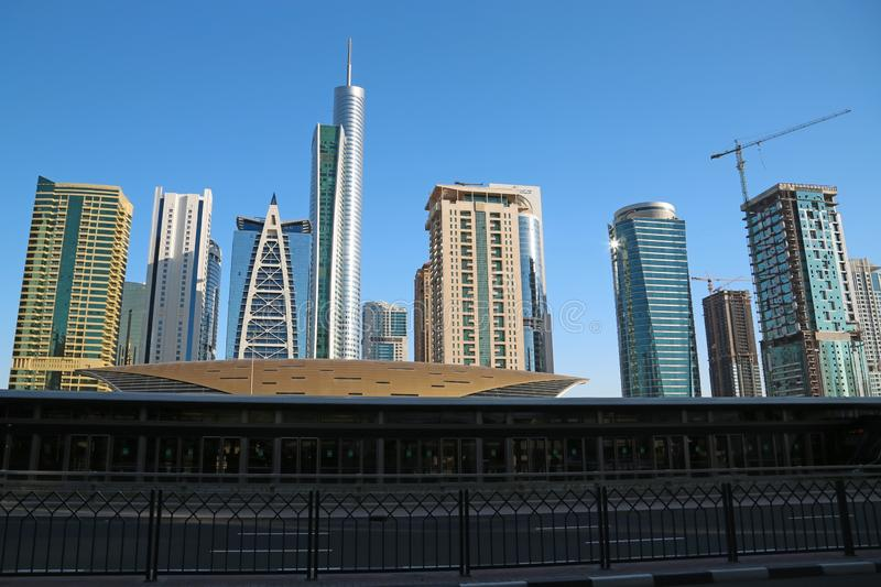 Almas tower and Jumeirah Lakes Towers, Dubai Multi Commodities Centre, UAE. UAE, DUBAI, FEBRUARY 5, 2016: Almas Tower supertall skyscraper and Jumeirah Lakes royalty free stock photography