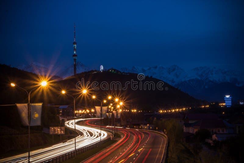 Almaty city night view, Kok Tobe hill. Lights trails at night on royalty free stock photo