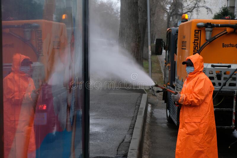 Almaty / Kazakhstan - 03.23.2020 : a utility employee works during quarantine stock photos
