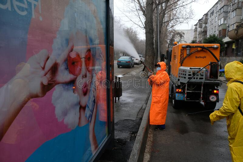 Almaty / Kazakhstan - 03.23.2020 : watering from a hose disinfectant stock photography