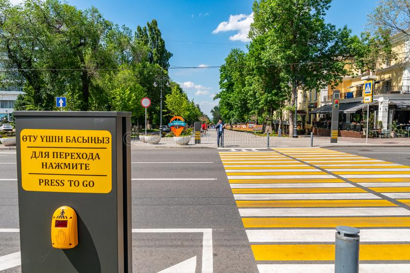 Almaty Panfilov Street 136. Almaty Panfilov Walking Street with Crosswalk and Turned on Red Traffic Lights on a Sunny Blue Sky Day royalty free stock image