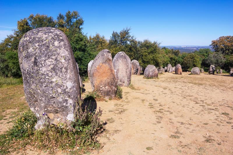 Almendres Cromlech, Ancient Megalithic Monument of Standing Stones royalty free stock photo